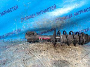 Стойка подвески на Toyota Vitz SCP90