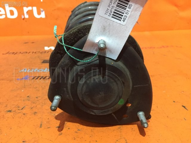 Стойка амортизатора на Toyota Porte NNP15 1NZ-FE