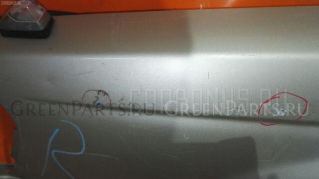 Крыло на Nissan Sunny FB15