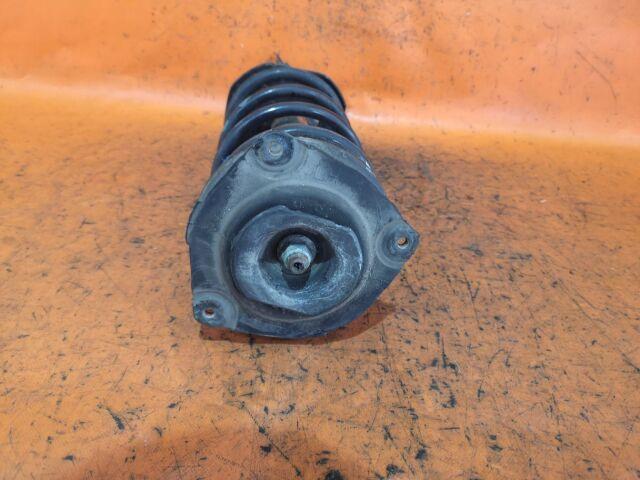 Стойка амортизатора на Nissan Tiida C11, JC11, NC11