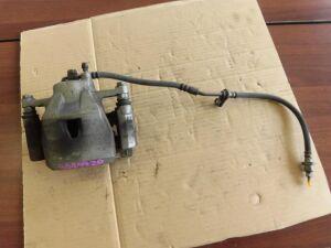 Суппорт на Toyota Porte NCP141 1NZ-FE