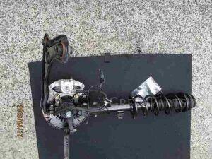 Стойка амортизатора на Nissan Note E12