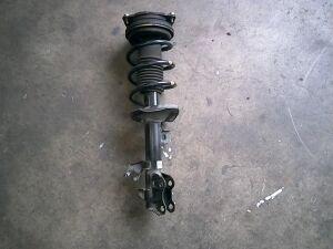 Стойка амортизатора на Nissan NV 200 BANET VM20 HR16DE