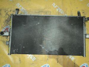 Радиатор кондиционера на Nissan Liberty M12